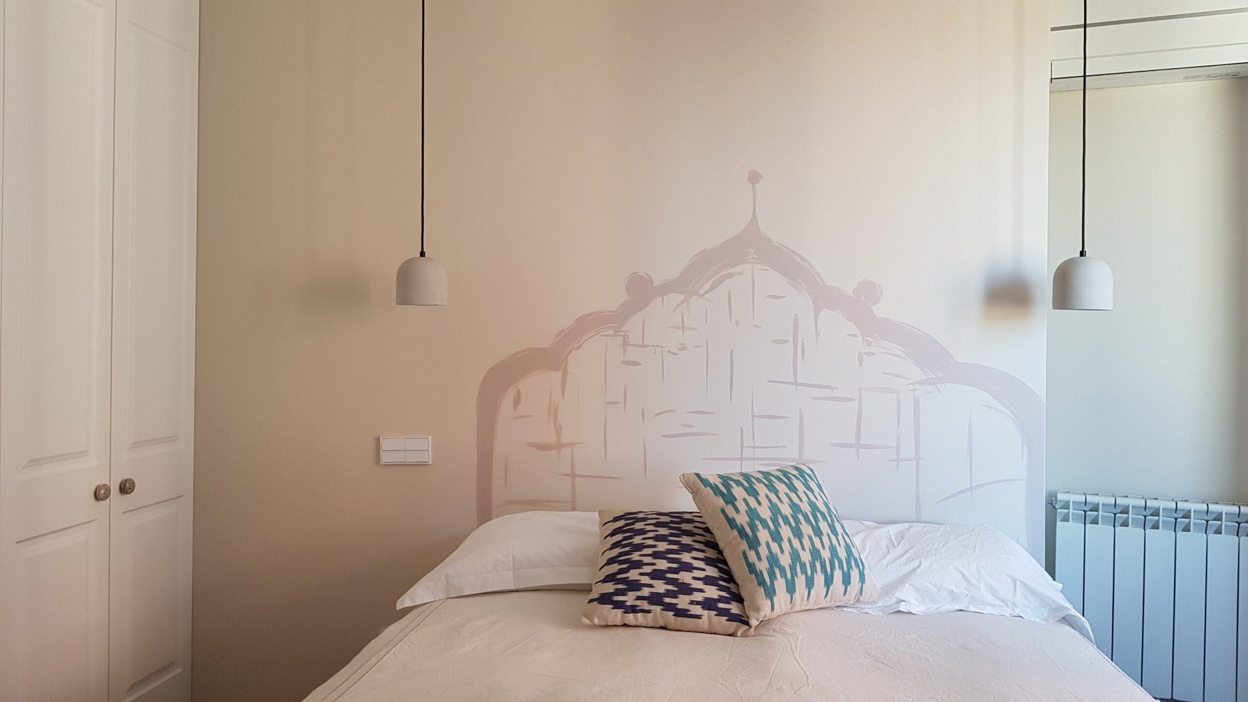 Cabecero pintado en la pared