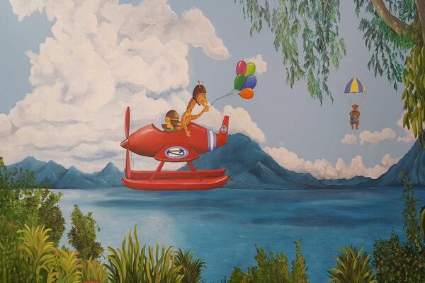 4 Mural nina volando en hidroavion con su jirafa 1